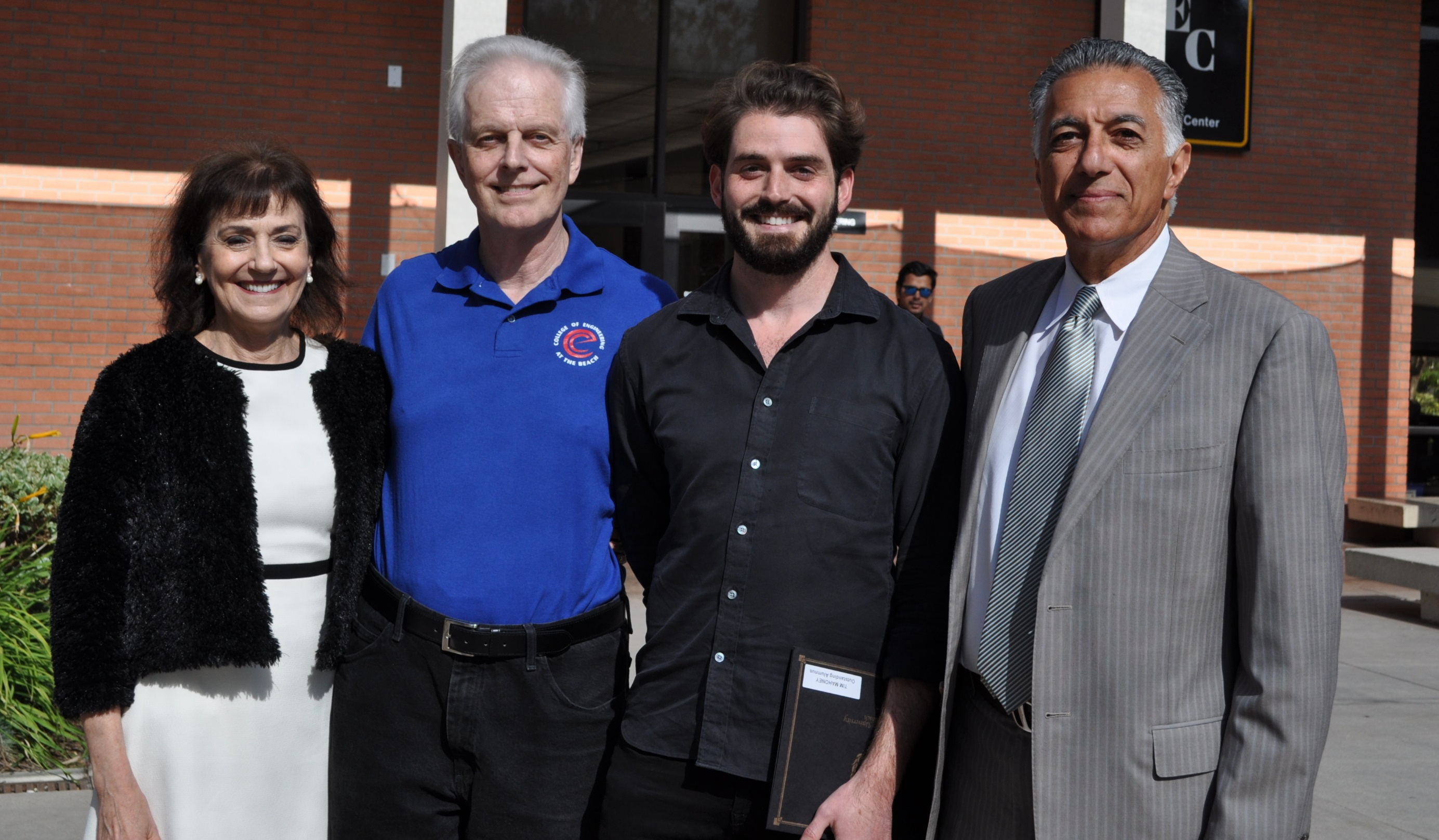 Group shot of Louise and Mike Mahoney, left, with their son, Tom, and COE Dean Forouzan Golshani