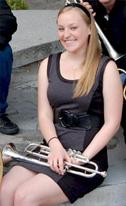 Esther Hood posing with her trumpet.