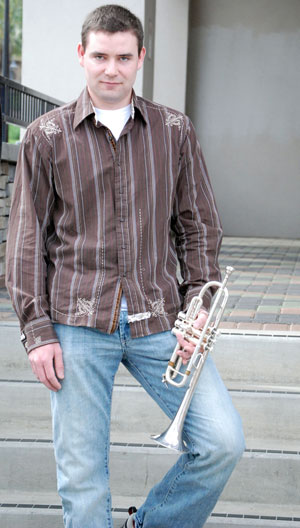 Portrait of Kurt standing on stairs with his trumpet.