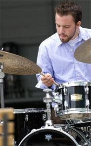 Portrait of Matt behind a drum kit.