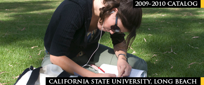 A CSULB Student works on the grass