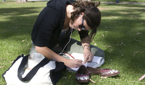 CSULB student studies on the grass