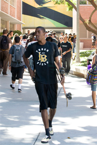 CSULB Track and Field Student with Skateboard