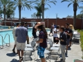 students playing musical chairs poolside