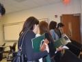 students leaving presentation