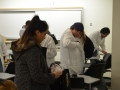 students putting on lab coats